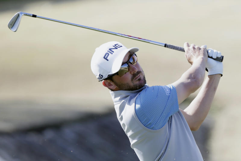 Andrew Landry follows through on the fourth tee during the final round of The American Express golf tournament on the Stadium Course at PGA West in La Quinta, Calif., Sunday, Jan. 19, 2020. (AP Photo/Alex Gallardo)