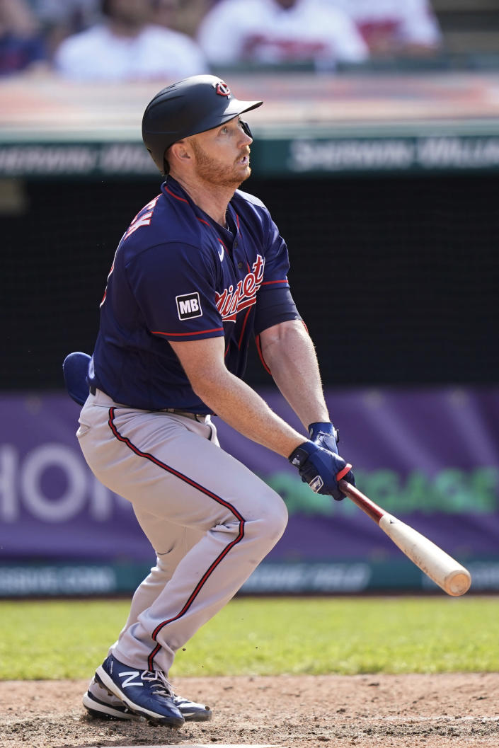 Minnesota Twins' Kyle Garlick watches his three-run home run-in the tenth inning of a baseball game against the Cleveland Indians, Sunday, May 23, 2021, in Cleveland. (AP Photo/Tony Dejak)