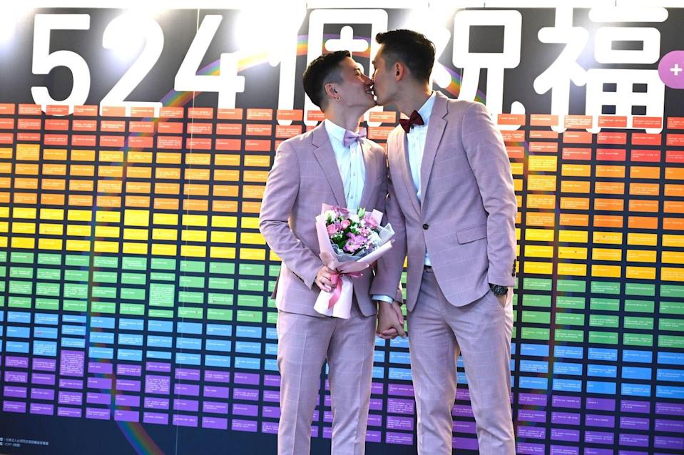 """<p>In May of 2019, Taiwan legalized same-sex marriage. Here, Shane Lin and Marc Yuan kiss outside the Household Registration Office after their nuptials. Taiwan was the first country in Asia to legalize same-sex marriage, joining the first Central American country to legalize same-sex marriage, Costa Rica. </p><p>To date, <a href=""""https://www.businessinsider.com/where-is-same-sex-marriage-legal-world-2017-11"""" rel=""""nofollow noopener"""" target=""""_blank"""" data-ylk=""""slk:according to Business Insider"""" class=""""link rapid-noclick-resp"""">according to Business Insider</a>, 29 countries around the world have ruled to legalize same-sex marriage.</p>"""