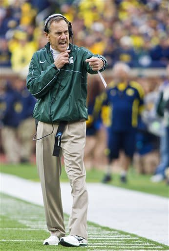 Michigan State head coach Mark Dantonio shouts at his team from the sidelines during the first quarter of an NCAA college football game against Michigan, Saturday, Oct. 20, 2012, in Ann Arbor, Mich. (AP Photo/Tony Ding)