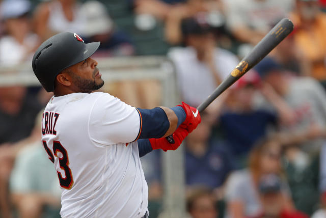 Minnesota Twins designated hitter Nelson Cruz drives in a run with a double in the fifth inning of a spring training baseball game against the Boston Red Sox, Monday, March 18, 2019, in Fort Myers, Fla. Minnesota won 4-1. (AP Photo/John Bazemore)