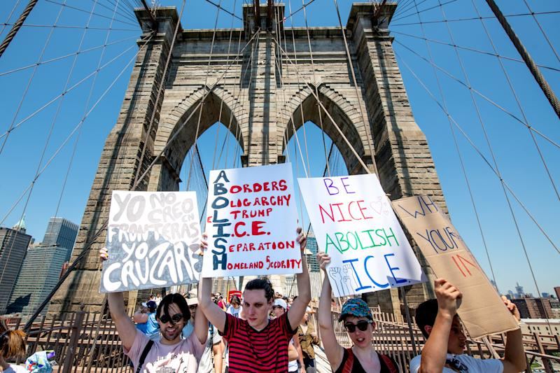 NEW YORK, NY - JUNE 30: Protesters march onthe Brooklyn Bridge during the Families Belong Together Rally and March in New York City on June 30, 2018 in New York City. (Photo by Roy Rochlin/Getty Images)