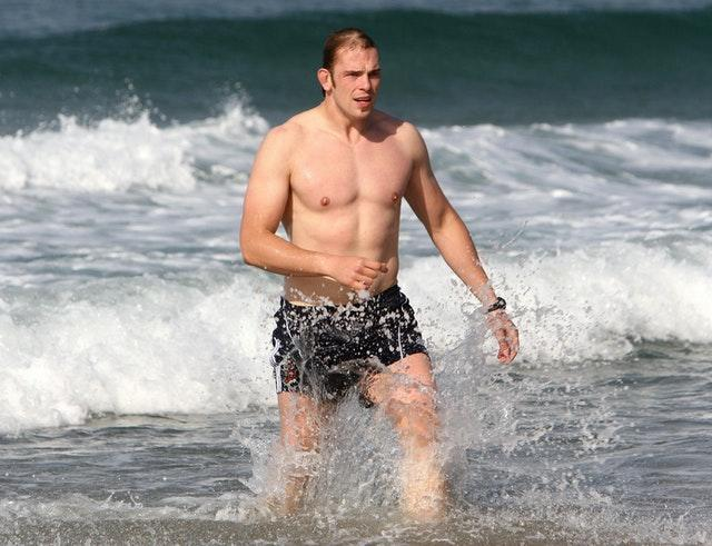 Alun Wyn Jones in the sea during his first British and Irish Lions tour, to South Africa in 2009