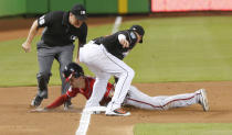 Miami Marlins third baseman Miguel Rojas applies a late tag on Washington Nationals' Trea Turner, who stole third during the first inning of a baseball game Saturday, July 28, 2018, in Miami. (AP Photo/Brynn Anderson)