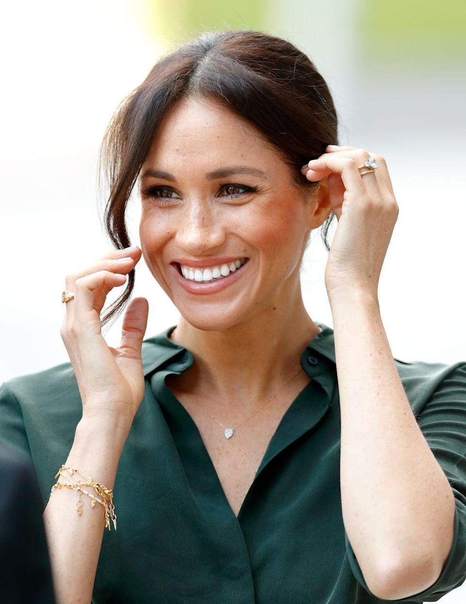 <p>Meghan's wedding band is also gold in keeping with royal tradition. She sported gold charm bracelets, a gold ring, and a matching necklace to an appearance at the University of Chichester in May 2018. <br></p>