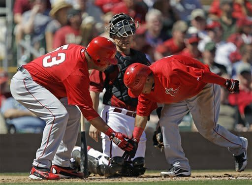 Los Angeles Angels' Alexi Amarista, right, is greeted at the plate by Bobby Abreu after Amarista's solo home run against the Arizona Diamondbacks during the third inning of a spring training baseball game Tuesday, March 13, 2012, in Scottsdale, Ariz. (AP Photo/Marcio Jose Sanchez)