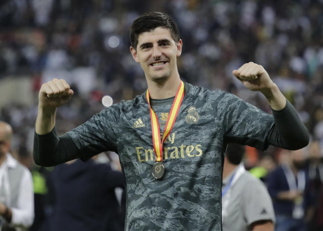 Real Madrid's goalkeeper Thibaut Courtois celebrates at the end of the Spanish Super Cup Final soccer match between Real Madrid and Atletico Madrid at King Abdullah stadium in Jiddah, Saudi Arabia, Monday, Jan. 13, 2020. (AP Photo/Hassan Ammar)