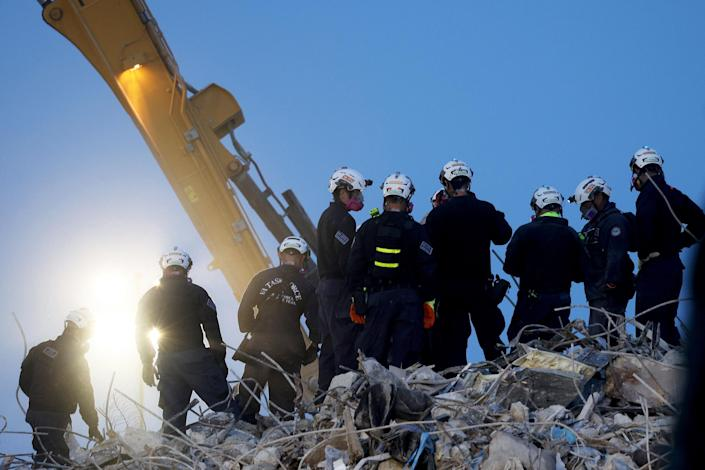 IMAGE: An excavator digs through the Champlain Towers South building Friday in Surfside, Fla. (Anna Moneymaker / Getty Images)