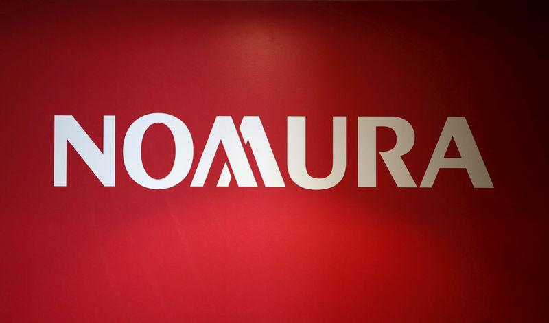 FILE PHOTO: Logo of Nomura Holdings is pictured in Tokyo