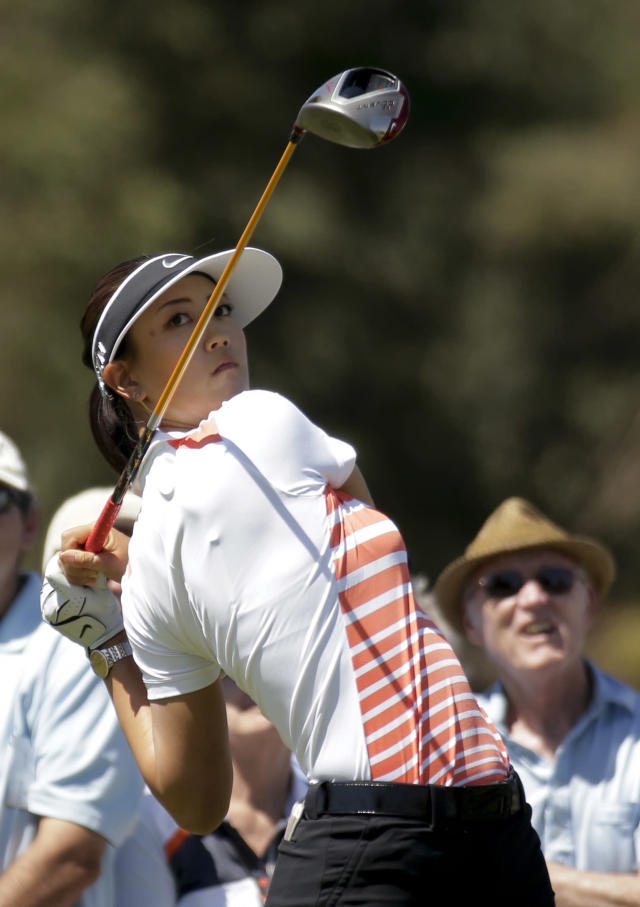 Michelle Wie watches her tee shot on the second hole during the third round of the Kraft Nabisco Championship golf tournament Saturday, April 5, 2014 in Rancho Mirage, Calif. (AP Photo/Chris Carlson)