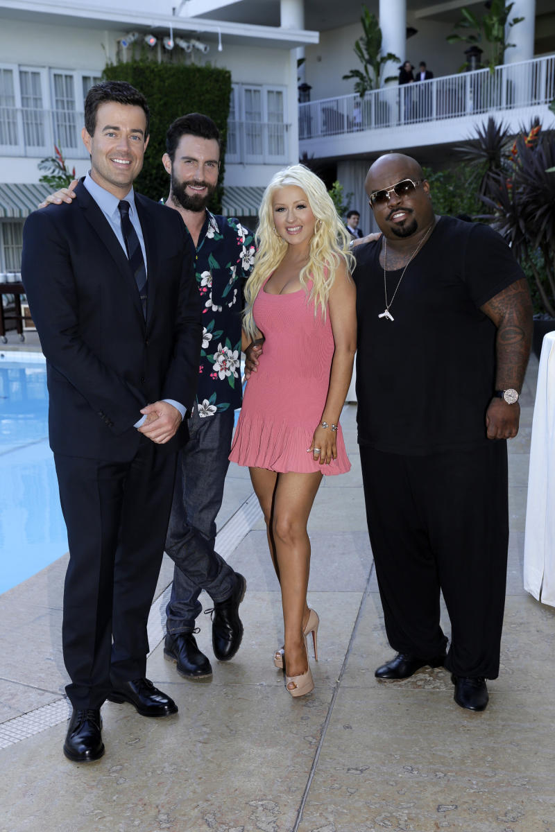 """This July 27, 2013 photo released by NBC shows, from left, host Carson Daly, with coaches, Adam Levine, Christina Aguilera and CeeLo Green of """"The Voice,"""" at the """"NBC Cocktail Reception"""" during the NBCUniversal Press Tour, in Beverly Hills, Calif. She hasn't had a trophy to show in her three years of coaching and trying to change that this year. Maroon 5 frontman Levine has won once, while country singer Blake Shelton has held the title three years running. (AP Photo/NBC, Paul Drinkwater)"""