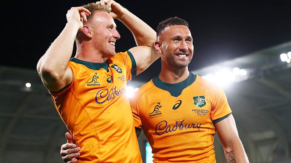 Wallabies duo Reece Hodge and Quade Cooper celebrate after Cooper's match-winning penalty against South Africa.