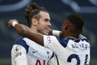 Tottenham's Gareth Bale, centre, celebrates with Tottenham's Serge Aurier after scoring his side's fourth goal during an English Premier League soccer match between Tottenham Hotspur and Burnley at the Tottenham Hotspur Stadium in London, England, Sunday, Feb. 28. 2021. (Matthew Childs/Pool via AP)