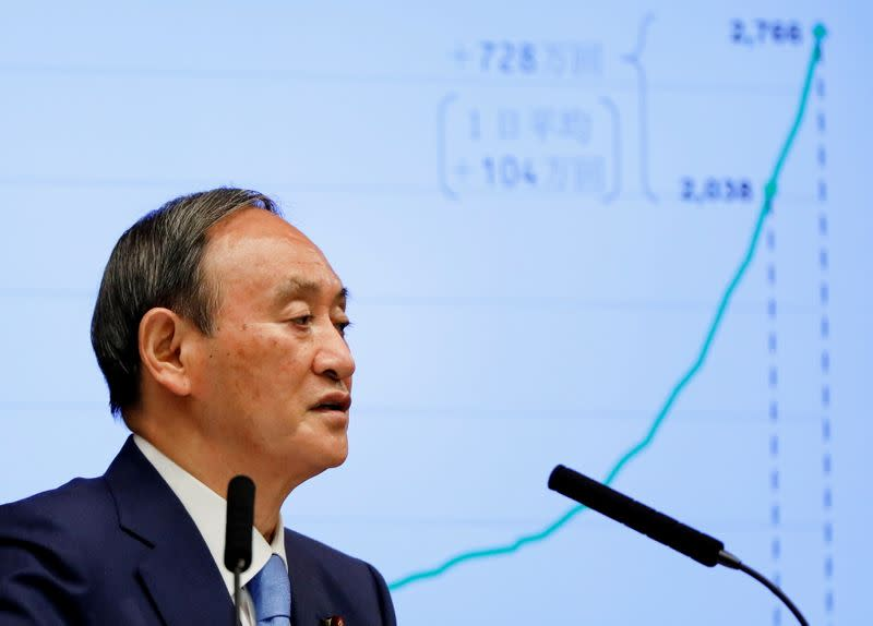 FILE PHOTO: FILE PHOTO: Japanese Prime Minister Yoshihide Suga attends a news conference on Japan's response to the COVID-19 outbreak, in Tokyo