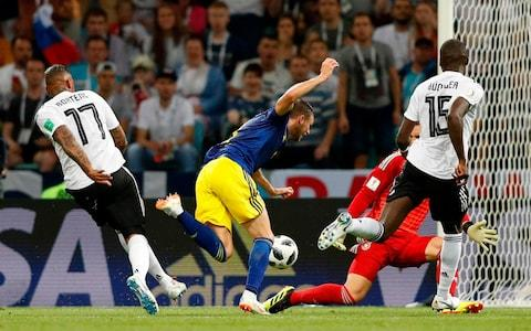 Berg goes tumbling as Boateng closes in - Credit: AFP