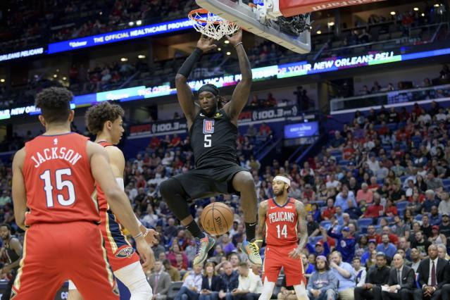 Los Angeles Clippers forward Montrezl Harrell (5) dunks against the New Orleans Pelicans in the first half an NBA basketball game in New Orleans, Saturday, Jan. 18, 2020. (AP Photo/Matthew Hinton)