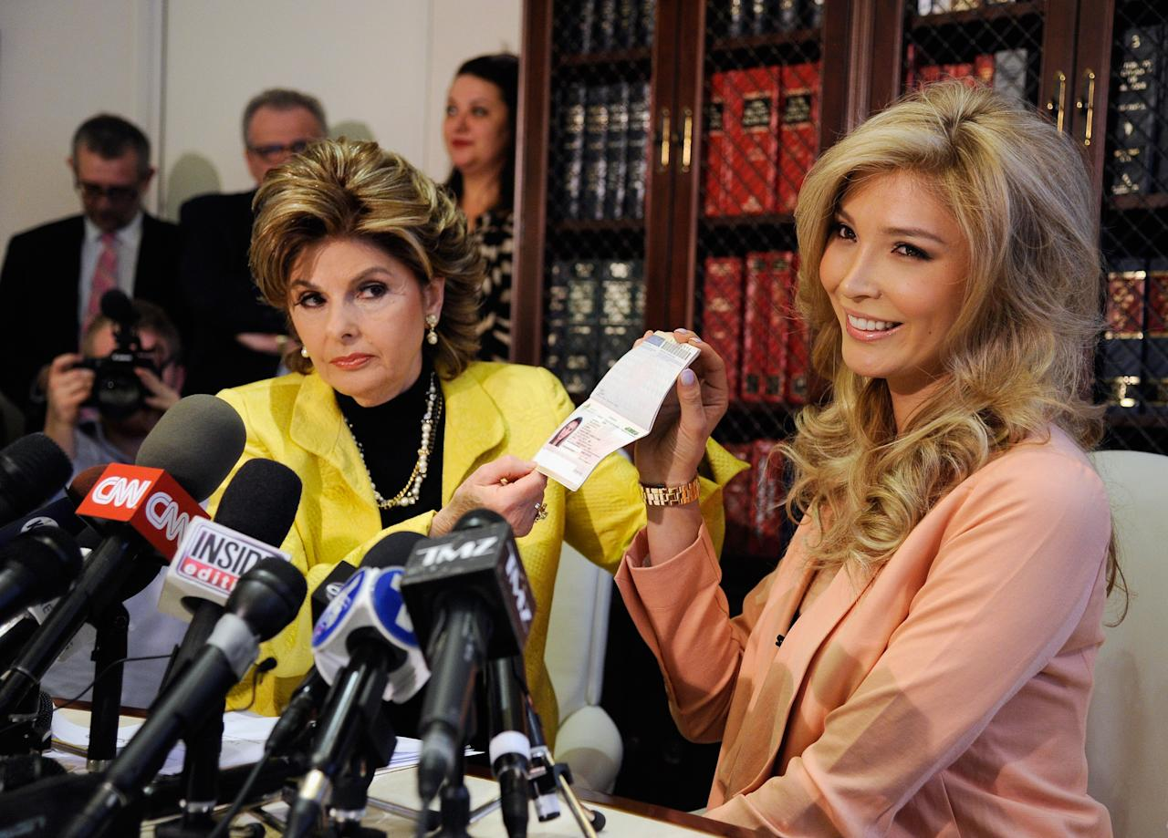 LOS ANGELES, CA - APRIL 03:  Jena Talackova (R), a would be Miss Universe contestant, shows her Canadian passport, as a proof that she is a female, during a news conference with her attorney Gloria Allred on April 3, 2012 in Los Angeles, California, 23, was disqualified as a finalist from the upcoming Miss Universe Canada last month because she was born male. The Miss Universe Organization reversed their decision April 2, 2012, allowing a transgender contestant to compete as long as they meet the legal Canadian gender recognition requirements and standards that are established by other competitions held internationally.  (Photo by Kevork Djansezian/Getty Images)