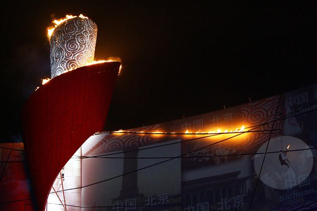 The Olympic Flame is lit by former gymnast Li Ning  during the Opening Ceremony for the 2008 Beijing Summer Olympics at the National Stadium on August 8, 2008 in Beijing, China.  (Photo by Jeff Gross/Getty Images)