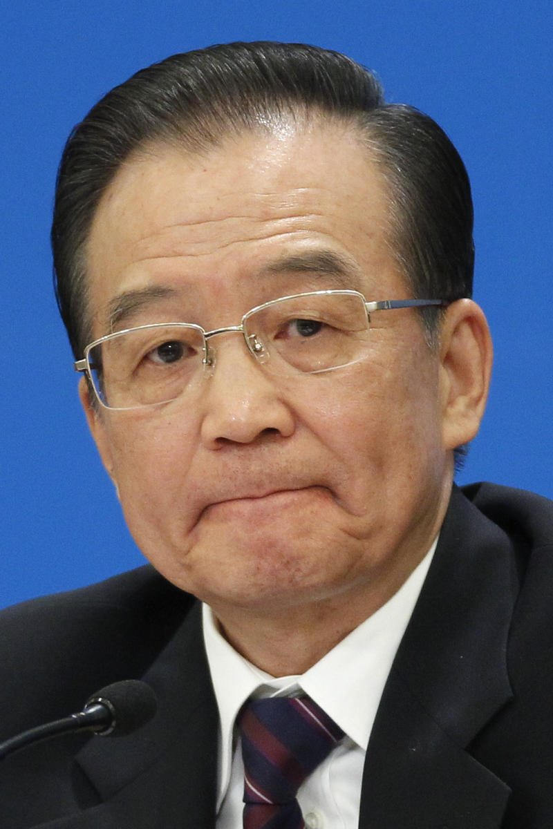 Chinese Premier Wen Jiabao reacts during a press conference after the closing session of the annual National People's Congress held in Beijing's Great Hall of the People, in China, Wednesday, March 14, 2012.  Wen, entering his final year as China's premier, called Wednesday for vague political reforms to forestall chaos and solidify growth as the nation's legislature approved a budget aiming to boost domestic consumption in the face of weak demand for exports.   (AP Photo/Alexander F. Yuan)