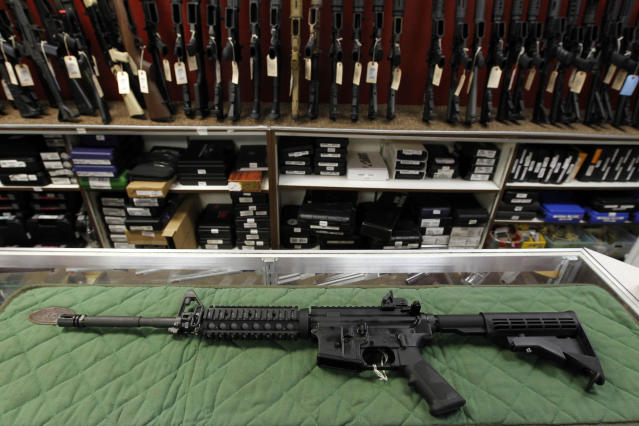 FILE - In this Thursday, July 26, 2012 file photo, an AR-15 style rifle is displayed at the Firing-Line indoor range and gun shop, in Aurora, Colo. A new poll shows a majority of Americans favor stricter gun laws, and most believe schools and places of worship have become less safe over the last two decades, according to a poll conducted by The Associated Press-NORC Center for Public Affairs Research both before and after last week's mass shooting at two mosques in New Zealand. (AP Photo/Alex Brandon, File)