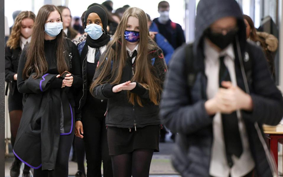 Older teenagers are able to transmit the virus as adults, Prof Ferguson said - Getty Images Europe