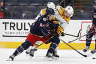 Nashville Predators' Alexandre Carrier, right, and Columbus Blue Jackets' Alexandre Texier fight for the puck during the second period of an NHL hockey game Monday, May 3, 2021, in Columbus, Ohio. (AP Photo/Jay LaPrete)