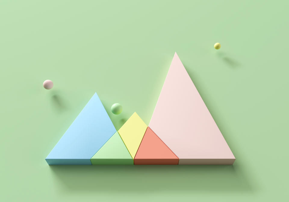 Digital generated image of abstract pastel colored intersected triangular shaped diagram on green background.