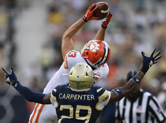 Clemson wide receiver Hunter Renfrow (13) makes a catch against Georgia Tech defensive back Tariq Carpenter (29) during the first half of an NCAA college football game, Saturday, Sept. 22, 2018, in Atlanta. (AP Photo/Mike Stewart)