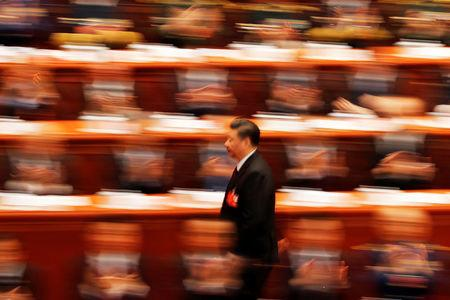 Chinese President Xi Jinping walks to deliver his speech at the closing session of the National People's Congress (NPC) at the Great Hall of the People in Beijing, China March 20, 2018. Picture taken with a slow shutter speed. REUTERS/Damir Sagolj     TPX IMAGES OF THE DAY