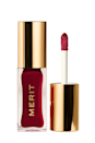 """<p><strong>MERIT</strong></p><p>sephora.com</p><p><strong>$24.00</strong></p><p><a href=""""https://go.redirectingat.com?id=74968X1596630&url=https%3A%2F%2Fwww.sephora.com%2Fproduct%2Fmerit-shade-slick-tinted-lip-oil-P468691&sref=https%3A%2F%2Fwww.cosmopolitan.com%2Fstyle-beauty%2Fbeauty%2Fg35911506%2Fbest-lip-oils%2F"""" rel=""""nofollow noopener"""" target=""""_blank"""" data-ylk=""""slk:Shop Now"""" class=""""link rapid-noclick-resp"""">Shop Now</a></p><p>I'll let you in on a little secret: This tinted lip oil is the only reason I look semi-alive on Zoom calls. One quick swipe gives me a soft, natural-looking wash of color, and the formula's blend of rosehip oil, shea butter, and grapeseed oil <strong>keeps my lips <em>hella</em> soft</strong>. Bonus: It's also <a href=""""https://www.cosmopolitan.com/style-beauty/beauty/a34024982/fragrance-free-skincare-routine-essay/"""" rel=""""nofollow noopener"""" target=""""_blank"""" data-ylk=""""slk:fragrance-free"""" class=""""link rapid-noclick-resp"""">fragrance-free</a>, so it's even safe for sensitive skin.</p>"""