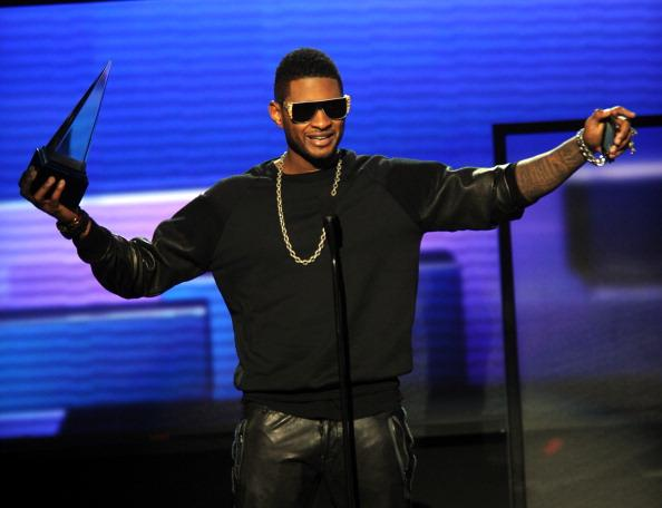 LOS ANGELES, CA - NOVEMBER 18:  Singer Usher accepts the award for Favorite Soul/R&B Male Artist onstage during the 40th American Music Awards held at Nokia Theatre L.A. Live on November 18, 2012 in Los Angeles, California.  (Photo by Kevin Winter/Getty Images)