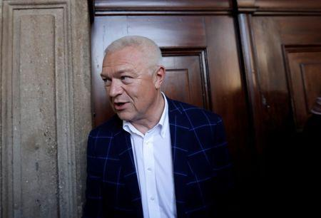 The deputy chairman of ANO party Jaroslav Faltynek leaves the Czech Parliament after negotiations with other parties following the country's parliamentary elections in Prague