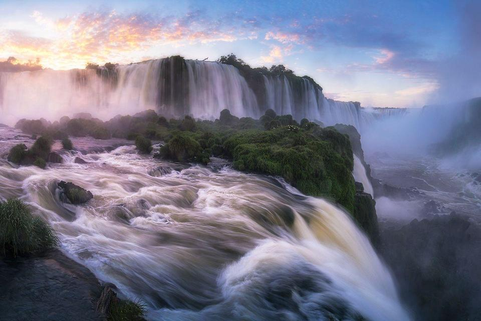 "<p>The <a href=""https://www.tripadvisor.com/Attraction_Review-g312804-d2037770-Reviews-Iguazu_Falls-Iguazu_National_Park_Province_of_Misiones_Litoral.html"" rel=""nofollow noopener"" target=""_blank"" data-ylk=""slk:Iguazu waterfalls"" class=""link rapid-noclick-resp"">Iguazu waterfalls</a> border the Argentine province of Misiones and the Brazilian state of Paraná. It is the largest natural waterfall complex in the world.</p>"