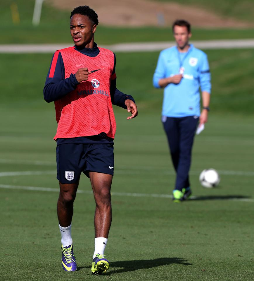 England's U21 player Raheem Sterling watched by Manager Gareth Southgate (right) during a training session at St George's Park, Burton.