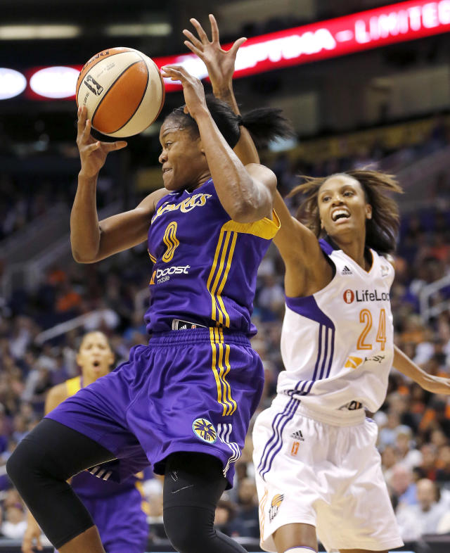 Los Angeles Sparks' Alana Beard (0) pulls down a rebound over Phoenix Mercury's DeWanna Bonner (24) during the first half of Game 2 of a WNBA basketball Western Conference semifinal series, Saturday, Sept. 21, 2013, in Phoenix. (AP Photo/Matt York)
