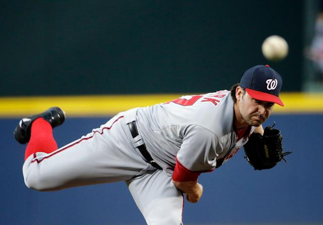 Washington Nationals starting pitcher Tanner Roark throws in the first inning of a baseball game against the Atlanta Braves, Friday, April 11, 2014, in Atlanta. (AP Photo/David Goldman)