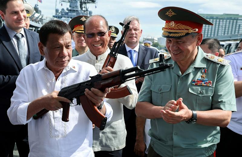 Last month Russia handed over army trucks and thousands of Kalashnikov assault rifles to Duterte (L) during a visit by Russian Defence Minister Sergei Shoigu (R), a first-ever visit by a Russian defence minister to the US ally