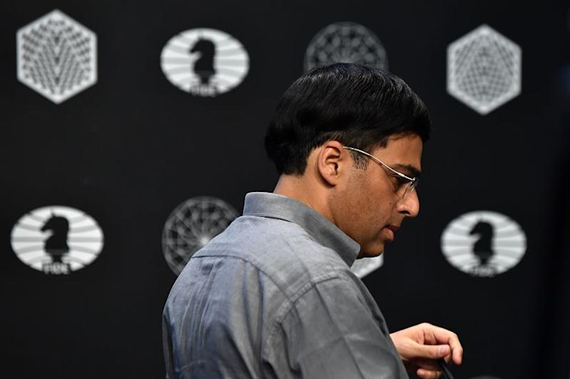 Indian Grandmaster Viswanathan Anand plays against Bulgarian Grandmaster Veselin Topalov (not pictured) during the first round of the Candidates Tournament in 2016. AFP