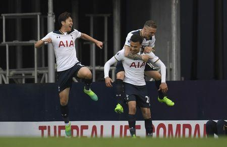 Britain Football Soccer - Tottenham Hotspur v Arsenal - Premier League - White Hart Lane - 30/4/17 Tottenham's Dele Alli celebrates scoring their first goal with teammates Reuters / Toby Melville Livepic