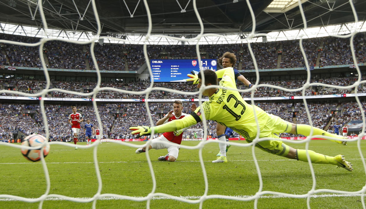 """Britain Football Soccer - Arsenal v Chelsea - FA Cup Final - Wembley Stadium - 27/5/17 Arsenal's Aaron Ramsey scores their second goal Action Images via Reuters / John Sibley Livepic EDITORIAL USE ONLY. No use with unauthorized audio, video, data, fixture lists, club/league logos or """"live"""" services. Online in-match use limited to 45 images, no video emulation. No use in betting, games or single club/league/player publications.  Please contact your account representative for further details."""