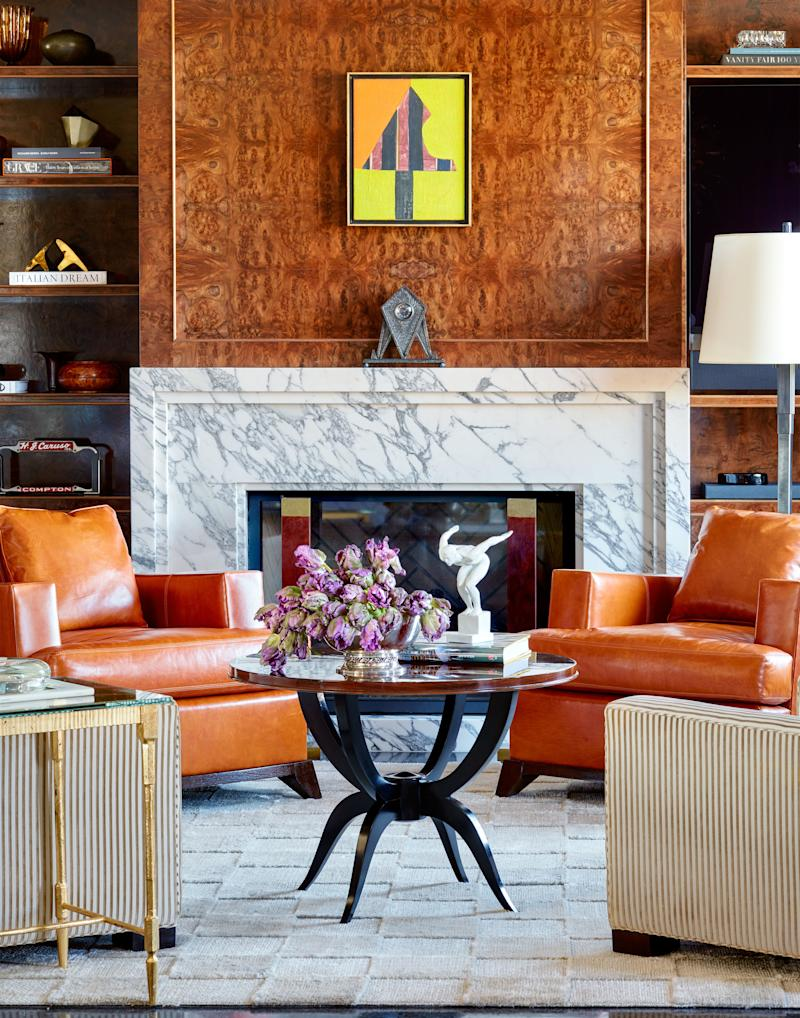 Burl-wood paneling wraps the lounge. Hand-knotted banana silk rug by Marc Phillips rugs.