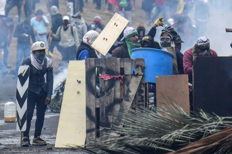 Demonstrators in Ecuador clash with riot police during a protest over a fuel price hike ordered by the government to secure an IMF loan