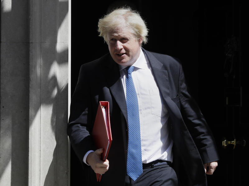 FILE - In this Wednesday, June 13, 2018 file photo, Britain's Foreign Minister Boris Johnson leaves 10 Downing Street in London. Britain's Conservative Party is holding an election to replace Prime Minister Theresa May, who resigned last week after failing to lead Britain out of the European Union on schedule. Nominations close Monday June 10, 2019 and former Foreign Minister Boris Johnson is currently the bookies' favorite to replace May. (AP Photo/Kirsty Wigglesworth, File)