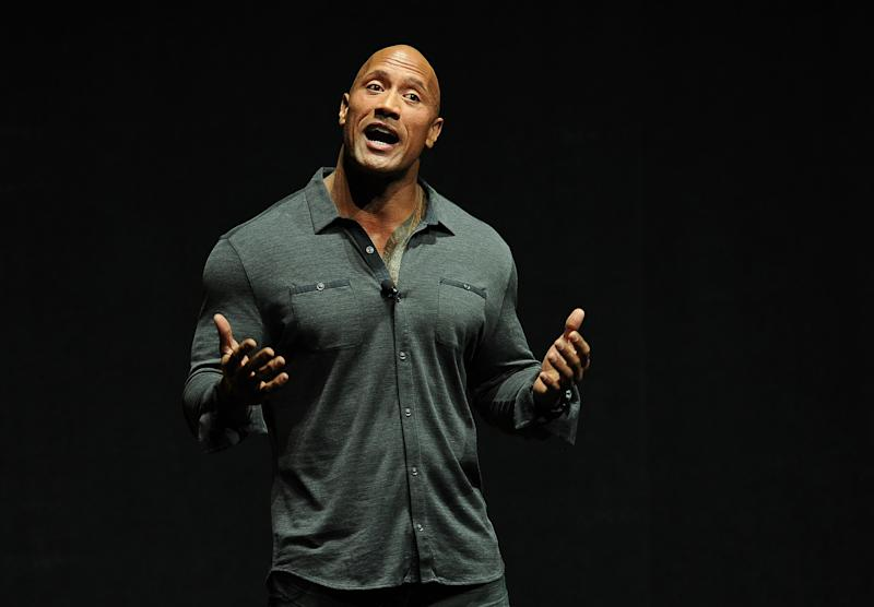 "Dwayne Johnson, star of the upcoming film ""Hercules,"" introduces a clip from the film at the Opening Night Presentation from Paramount Pictures at CinemaCon 2014 on Monday, March 24, 2014, in Las Vegas. (Photo by Chris Pizzello/Invision/AP)"