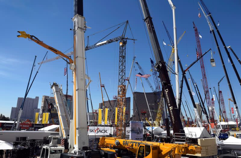 Cranes and other construction equipment are seen towering over Las Vegas hotels at CONEXPO-CON/AGG convention at the Las Vegas Convention Center in Las Vegas