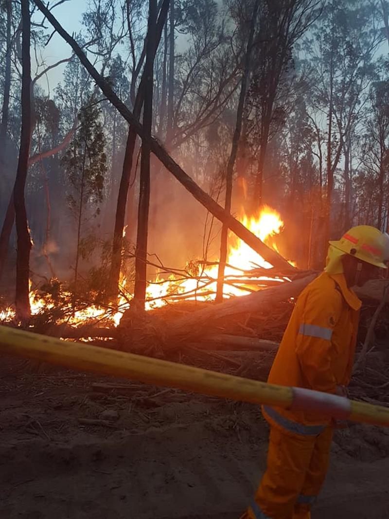 More than 40 fires are burning across Queensland, with at least 22 home destroyed. A photo of a fire Bracker Creek Rural Fire Brigade is battling.