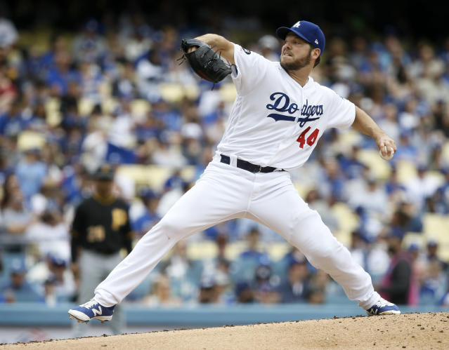 Los Angeles Dodgers starting pitcher Rich Hill delivers to a Pittsburgh Pirates batter during the second inning of a baseball game in Los Angeles, Sunday, April 28, 2019. (AP Photo/Alex Gallardo)