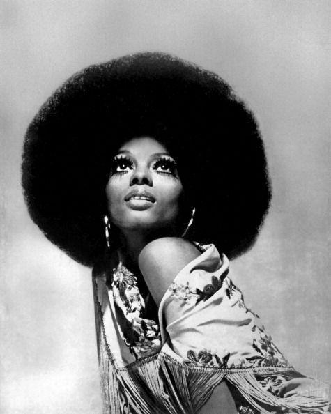 "<p>Diana Ross was known throughout her career for sporting <a href=""https://www.essence.com/celebrity/diana-ross-hair-journey/#60461"" rel=""nofollow noopener"" target=""_blank"" data-ylk=""slk:towering wigs of all different styles and volumes"" class=""link rapid-noclick-resp"">towering wigs of all different styles and volumes</a>. By the 1970s, she mostly alternated between a chic bob and a show-stopping afro.</p>"