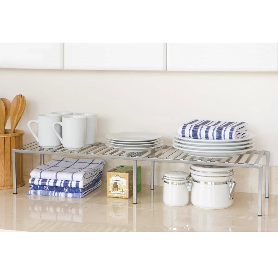 """<p>Give your pantry or countertop extra storage surface with the <a href=""""https://www.popsugar.com/buy/Seville-Expandable-Cabinet-Shelf-Organizer-472062?p_name=Seville%20Expandable%20Cabinet%20Shelf%20Organizer&retailer=target.com&pid=472062&price=21&evar1=moms%3Aus&evar9=46418295&evar98=https%3A%2F%2Fwww.popsugar.com%2Ffamily%2Fphoto-gallery%2F46418295%2Fimage%2F46418303%2FSeville-Expandable-Cabinet-Shelf-Organizer&list1=shopping%2Ctarget%2Corganization%2Chome%20shopping&prop13=api&pdata=1"""" rel=""""nofollow"""" data-shoppable-link=""""1"""" target=""""_blank"""" class=""""ga-track"""" data-ga-category=""""Related"""" data-ga-label=""""https://www.target.com/p/seville-expandable-cabinet-shelf-organizer-silver/-/A-53442386"""" data-ga-action=""""In-Line Links"""">Seville Expandable Cabinet Shelf Organizer </a> ($21).</p>"""