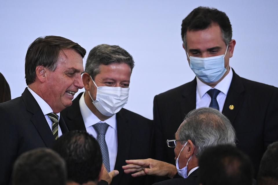 Brazil's President Jair Bolsonaro, next to President of Brazil's Lower House Arthur Lira and President of Brazil's Senate Rodrigo Pacheco, speaks with Brazil's Economy Minister Paulo Guedes after the launch ceremony of the platform Participa + Brasil, at the Planalto Palace, in Brasilia, Brasil, on February 8, 2020. (Photo by Andre Borges/NurPhoto via Getty Images)